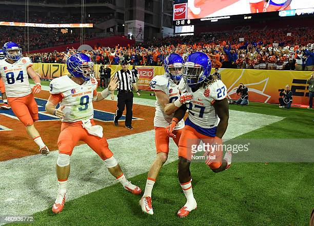 Jay Ajayi Grant Hedrick and Thomas Sperbeck of the Boise State Broncos celebrate a 56 yard touchdown during the first quarter against the Arizona...