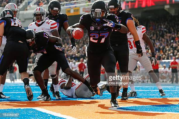 Jay Ajayi of the Boise State Broncos celebrates after a touchdown against the UNLV Rebels at Bronco Stadium on October 20 2012 in Boise Idaho