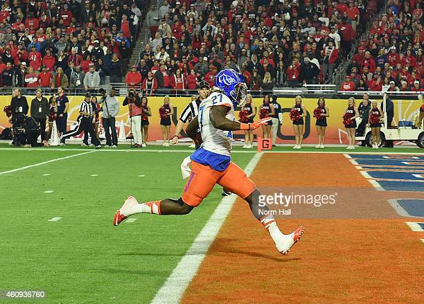 Jay Ajayi of the Boise State Broncos rushes for a 56 yard touchdown during the first quarter against the Arizona Wildcats at University of Phoenix...