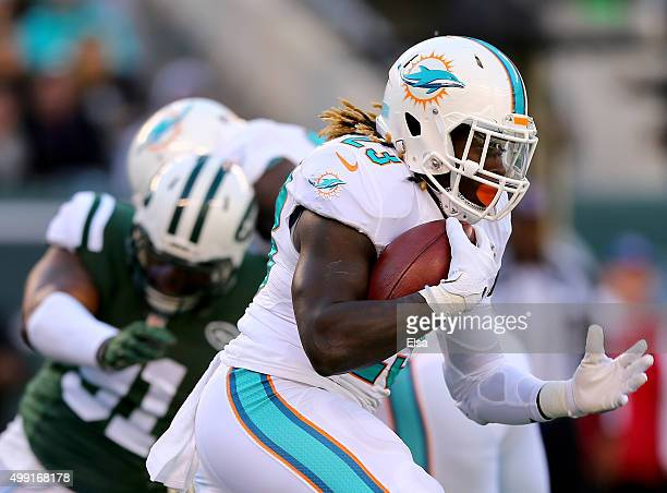Jay Ajayi of the Miami Dolphins carries the ball in the first half against the New York Jets on November 29 2015 at MetLife Stadium in East...