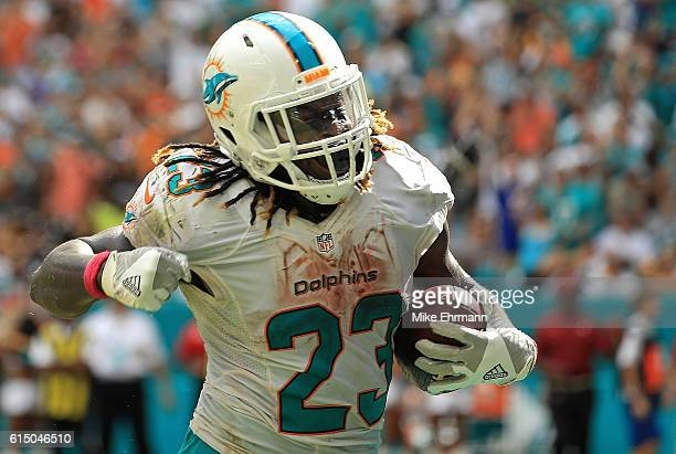 Jay Ajayi of the Miami Dolphins celebrates a touchdown during a game against the Pittsburgh Steelers on October 16 2016 in Miami Gardens Florida