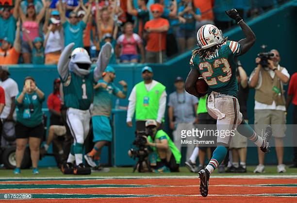 Jay Ajayi of the Miami Dolphins celebrates a touchdown during a game against the Buffalo Bills at Hard Rock Stadium on October 23 2016 in Miami...
