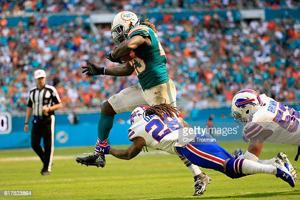 Jay Ajayi of the Miami Dolphins is tackled by Kevon Seymour of the Buffalo Bills at the Hard Rock Stadium on October 23 2016 in Miami Gardens Florida