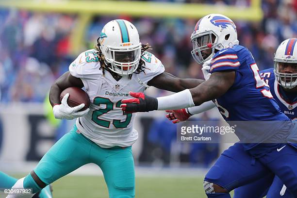 Jay Ajayi of the Miami Dolphins runs against the Buffalo Bills during the first half at New Era Stadium on December 24 2016 in Orchard Park New York