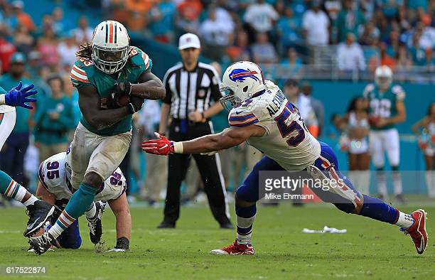 Jay Ajayi of the Miami Dolphins rushes during a game against the Buffalo Bills at Hard Rock Stadium on October 23 2016 in Miami Gardens Florida