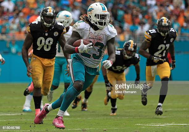 Jay Ajayi of the Miami Dolphins rushes during a game against the Pittsburgh Steelers on October 16 2016 in Miami Gardens Florida