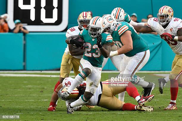 Jay Ajayi of the Miami Dolphins rushes during the 4th quarter against the San Francisco 49ers at Hard Rock Stadium on November 27 2016 in Miami...