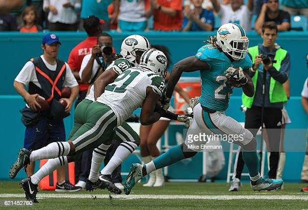 Jay Ajayi of the Miami Dolphins rushes for a touchdown during a game against the New York Jets at Hard Rock Stadium on November 6 2016 in Miami...