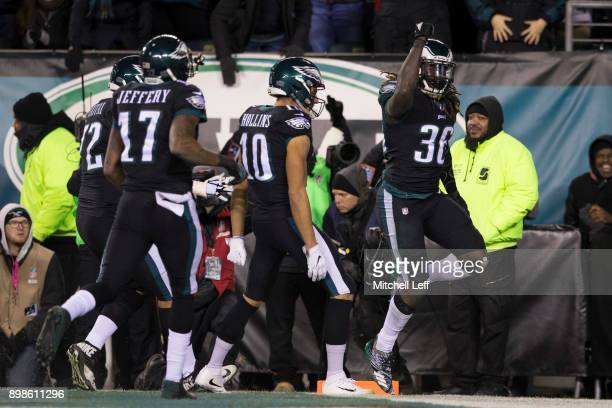 Jay Ajayi of the Philadelphia Eagles celebrates with Alshon Jeffery Halapoulivaati Vaitai and Mack Hollins after scoring a touchdown in the first...