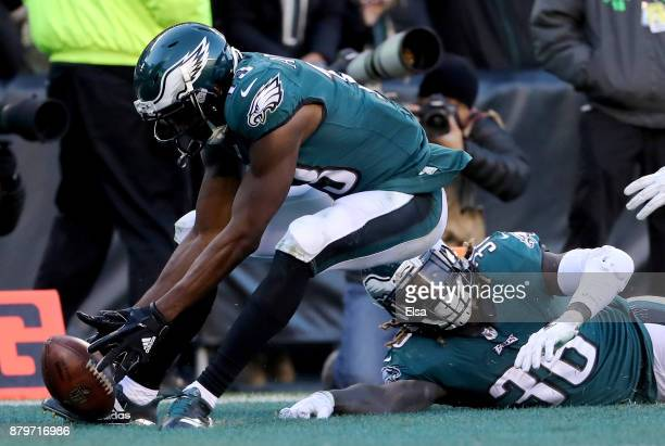Jay Ajayi of the Philadelphia Eagles fumbles the ball in the endzone as teammate Nelson Agholor recovers for the touchdown in the fourth quarter...