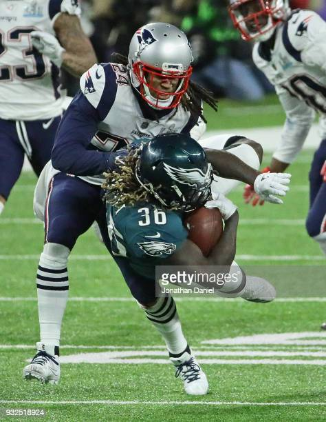 Jay Ajayi of the Philadelphia Eagles is hit by Stephon Gilmore of the New England Patriots during Super Bowl Lll at US Bank Stadium on February 4...