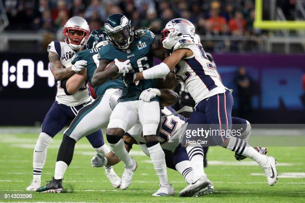 Jay Ajayi of the Philadelphia Eagles is tackled by Elandon Roberts of the New England Patriots during the first quarter in Super Bowl LII at US Bank...