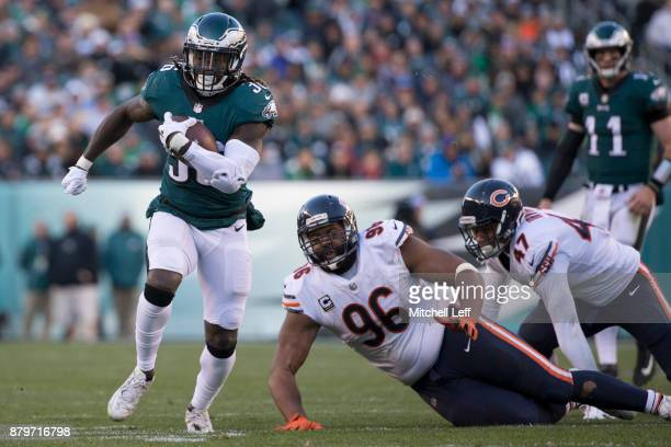 Jay Ajayi of the Philadelphia Eagles runs past Akiem Hicks and Isaiah Irving of the Chicago Bears in the fourth quarter at Lincoln Financial Field on...