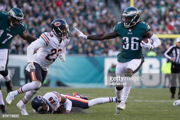 Jay Ajayi of the Philadelphia Eagles runs the ball against Kyle Fuller and Deon Bush of the Chicago Bears in the fourth quarter at Lincoln Financial...