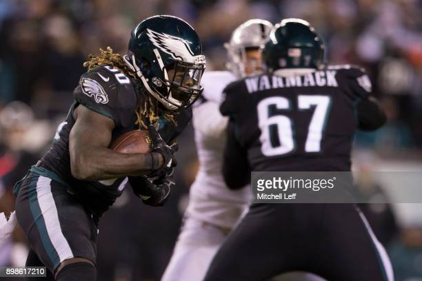Jay Ajayi of the Philadelphia Eagles runs the ball in the first quarter as Chance Warmack blocks against the Oakland Raiders at Lincoln Financial...