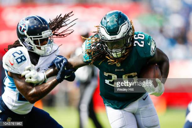 Jay Ajayi of the Philadelphia Eagles runs with the ball while defended by Kendrick Lewis of the Tennessee Titans in the third quarter at Nissan...