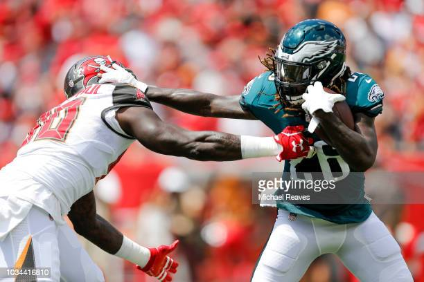 Jay Ajayi of the Philadelphia Eagles stiff arms Jason PierrePaul of the Tampa Bay Buccaneers during the first half at Raymond James Stadium on...