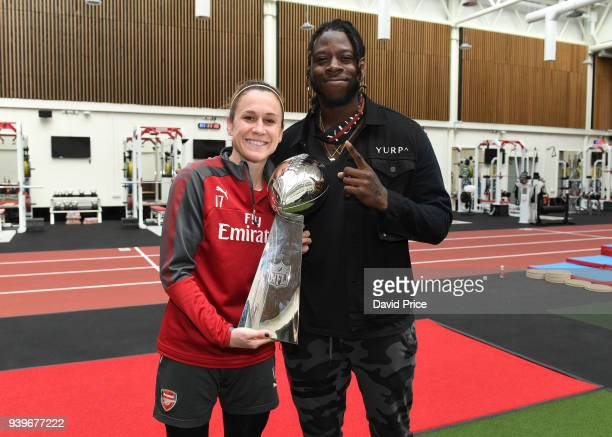 Jay Ajayi of the Philidelphia Eagles meets Heather O'Reilly of the Arsenal Women during his visit to the Arsenal Training Ground at London Colney on...