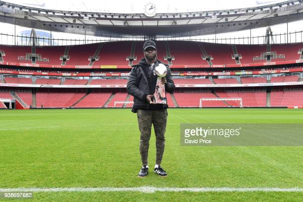 Jay Ajayi of the Philidephia Eagles holds the Vince Lombardi Trophy as he visits Arsenal Football Club's Emirates Stadium on March 27 2018 in London...