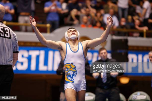 Jay Albis of Johnson Wales celebrates after winning his match in the 125 weight class during the Division III Men's Wrestling Championship held at...