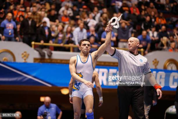 Jay Albis of Johnson Wales is declared the winner of his match in the 125 weight class during the Division III Men's Wrestling Championship held at...