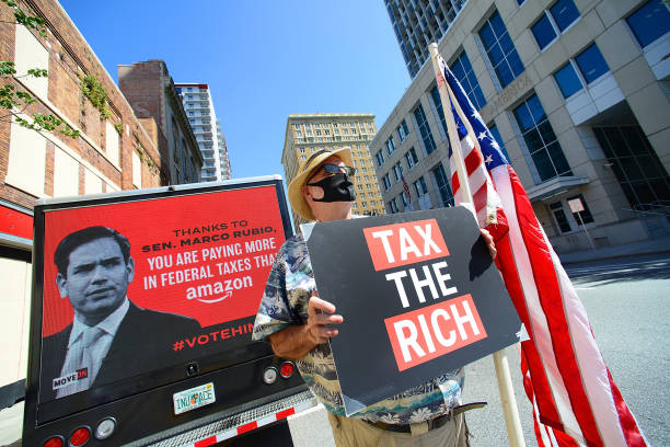 FL: #TaxTheRich Action With Billboard Truck At Sen. Marco Rubio's Tampa Office