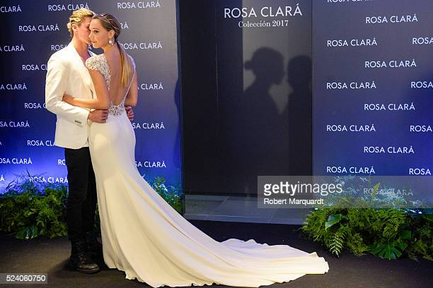 Jay Alvarrez and Alexis Ren pose during a photocall for 'Rosa Clara' Barcelona Bridal week fitting on April 25 2016 in Barcelona Spain