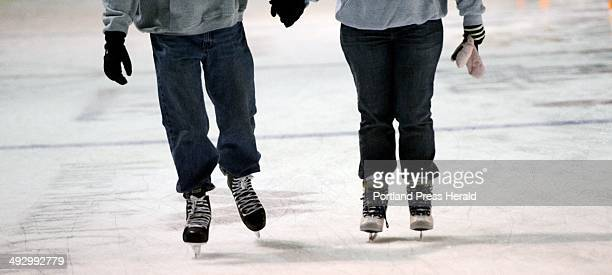 Jay and Sara Reynolds skate together during public skating at the Cumberland County Civic Center Sunday, December 30, 2012.