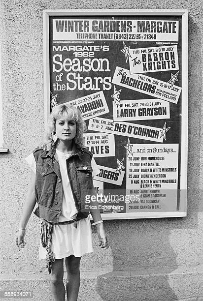 Jay Aston of Bucks Fizz in front of a poster advertising theline up for Margate's 1982 Summer Season Winter Gardens Margate United Kingdom 1982