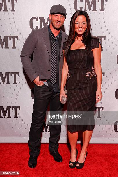 Jay Barker and Sara Evans attend CMT Artists of the Year 2011 at the Bridgestone Arena on November 29 2011 in Nashville Tennessee