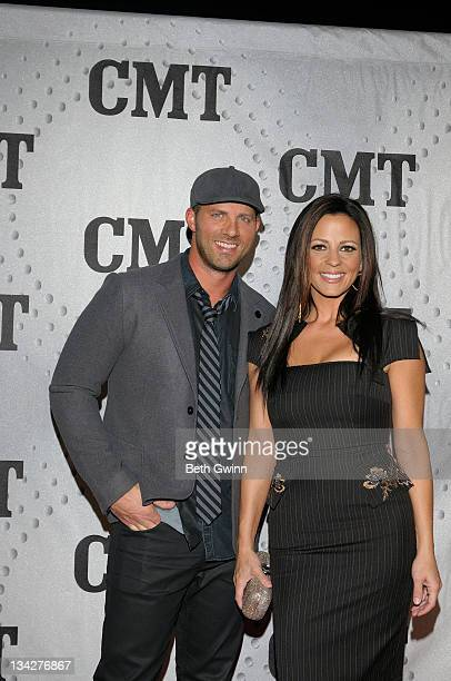 Jay Barker and Sara Evans attend CMT Artists of the Year 2011 at the Bridgestone Arena on November 29, 2011 in Nashville, Tennessee.