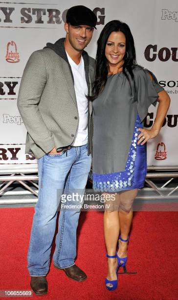 Jay Barker and Sara Evans attend the Country Strong premiere at Green Hills Cinema on November 8 2010 in Nashville Tennessee
