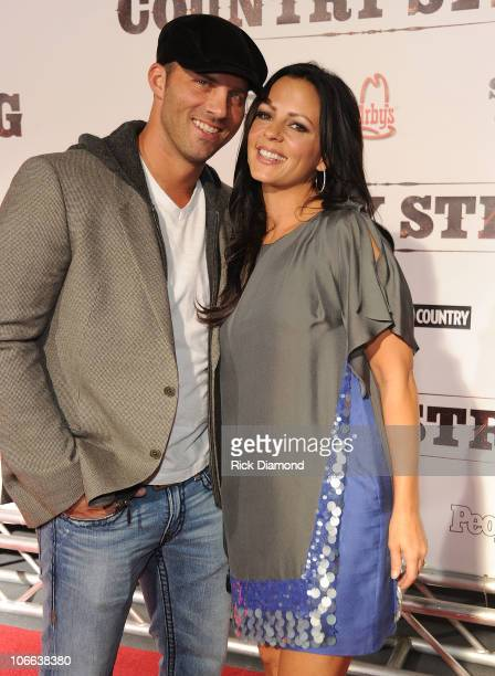 Jay Barker and singer Sara Evans attends the Country Strong Premiere at Regal Green Hills on November 8 2010 in Nashville Tennessee
