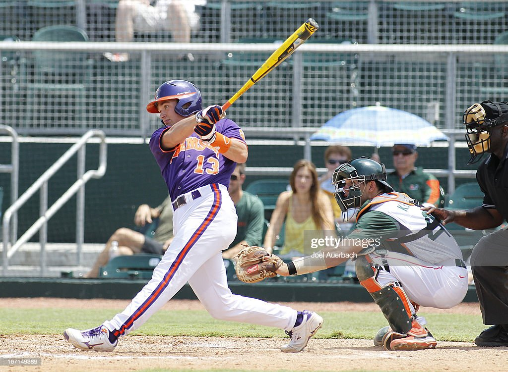 Jay Baum #13 of the Clemson Tigers hits the ball against the Miami Hurricanes on April 21, 2013 at Alex Rodriguez Park at Mark Light Field in Coral Gables, Florida. Miami defeated Clemson 7-0.