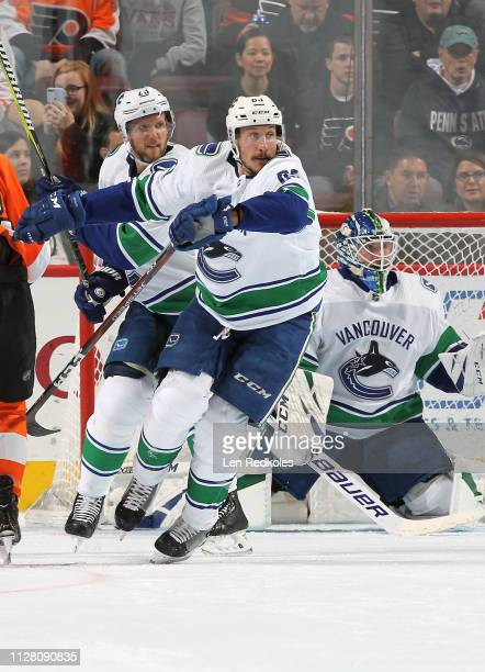 Jay Beagle Alexander Edler and Jacob Markstrom of the Vancouver Canucks react to the play against the Philadelphia Flyers on February 4 2019 at the...