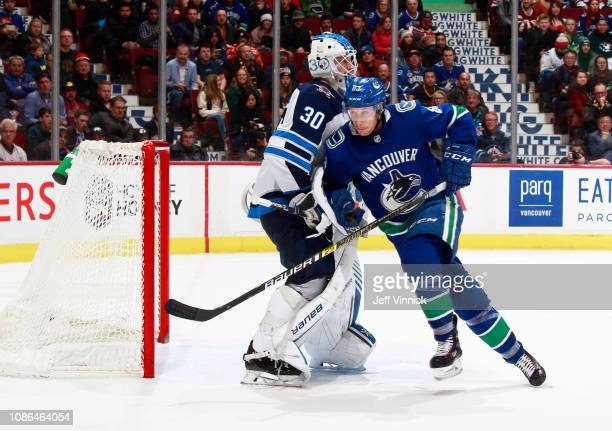 Jay Beagle of the Vancouver Canucks skates by Laurent Brossoit of the Winnipeg Jets during their NHL game at Rogers Arena December 22 2018 in...