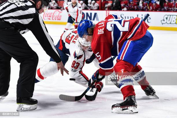 Jay Beagle of the Washington Capitals and Jacob De La Rose of the Montreal Canadiens faceoff during the NHL game at the Bell Centre on February 4...
