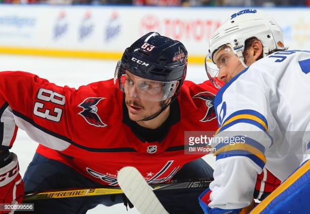 Jay Beagle of the Washington Capitals and Jacob Josefson of the Buffalo Sabres prepare for a faceoff during an NHL game on February 19 2018 at...