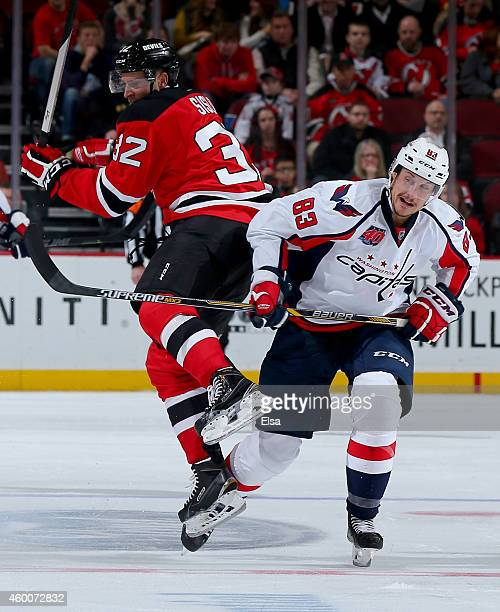 Jay Beagle of the Washington Capitals and Mike Sislo of the New Jersey  Devils collide in 4de23d042