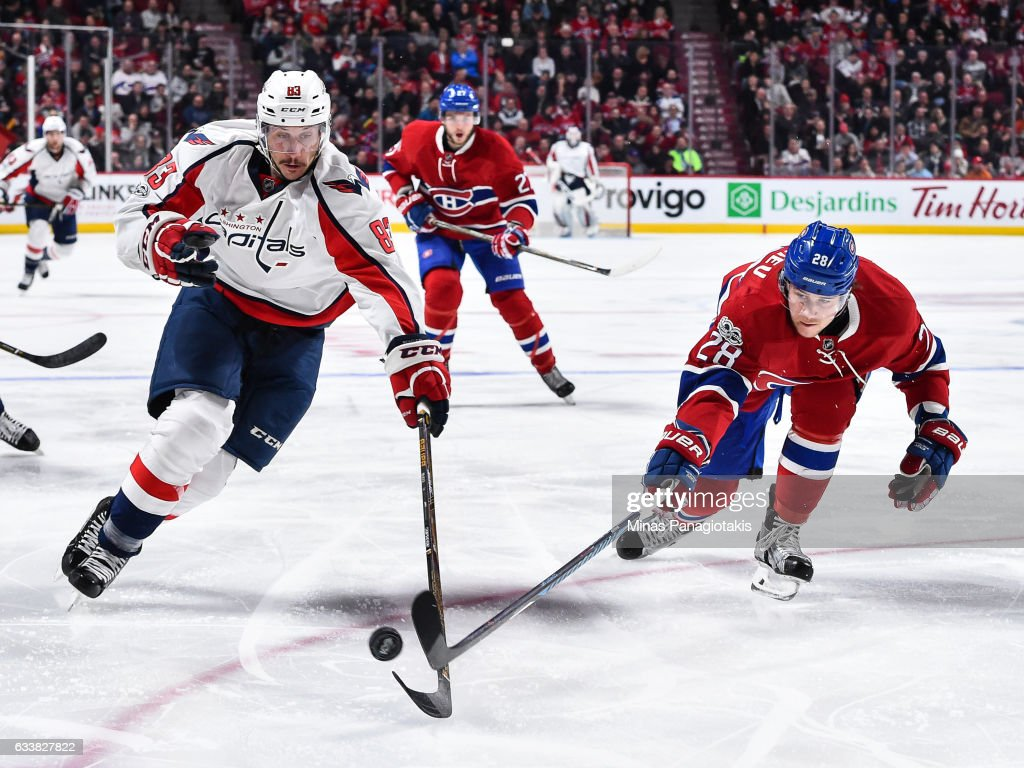 Jay Beagle #83 of the Washington Capitals and Nathan Beaulieu #28 of the Montreal Canadiens chase the puck during the NHL game at the Bell Centre on February 4, 2017 in Montreal, Quebec, Canada. The Washington Capitals defeated the Montreal Canadiens 3-2.
