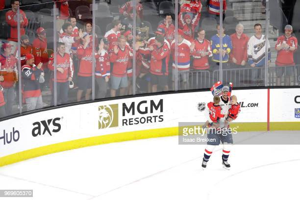 Jay Beagle of the Washington Capitals celebrates with his children after his team defeated the Vegas Golden Knights 43 in Game Five of the 2018 NHL...