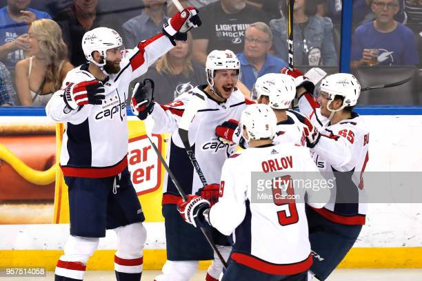 Jay Beagle of the Washington Capitals celebrates with his teammates after scoring a goal against Andrei Vasilevskiy of the Tampa Bay Lightning during...
