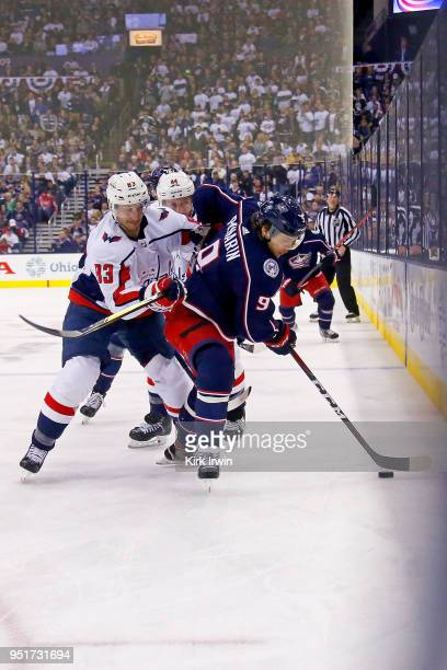 Jay Beagle of the Washington Capitals checks Artemi Panarin of the Columbus Blue Jackets in Game Six of the Eastern Conference First Round during the...