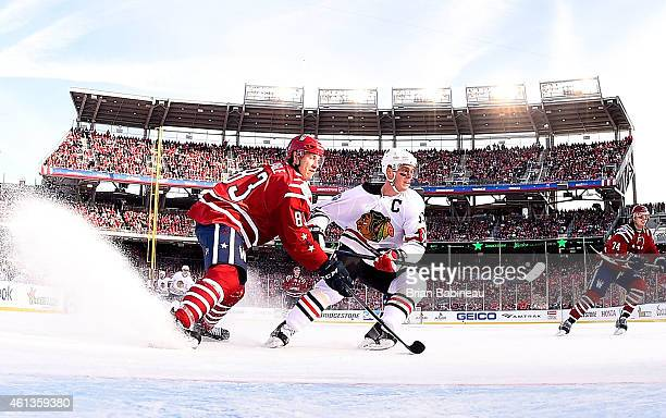 Jay Beagle of the Washington Capitals defends Jonathan Toews of the Chicago Blackhawks in the slot area in the second period of the 2015 Bridgestone...