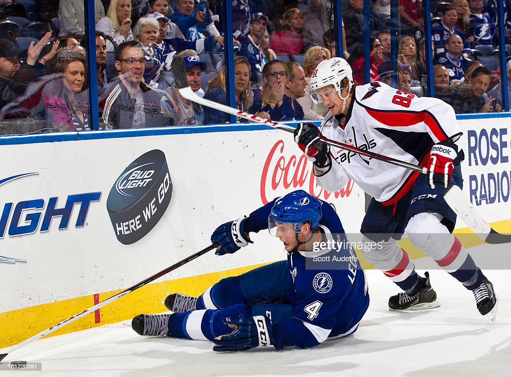 Jay Beagle #83 of the Washington Capitals fights for control of the puck with Vincent Lecavalier #4 of the Tampa Bay Lightning during the third period of the game at the Tampa Bay Times Forum on February 14, 2013 in Tampa, Florida.