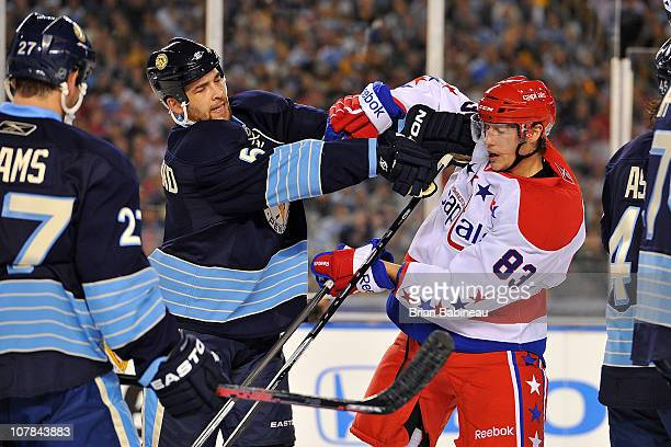 Jay Beagle of the Washington Capitals fights with Deryk Engelland of the Pittsburgh Penguins during the 2011 NHL Bridgestone Winter Classic at Heinz...
