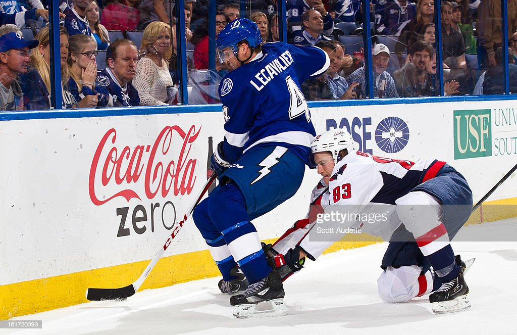 Jay Beagle #83 of the Washington Capitals hits Vincent Lecavalier #4 of the Tampa Bay Lightning during the third period of the game at the Tampa Bay Times Forum on February 14, 2013 in Tampa, Florida.