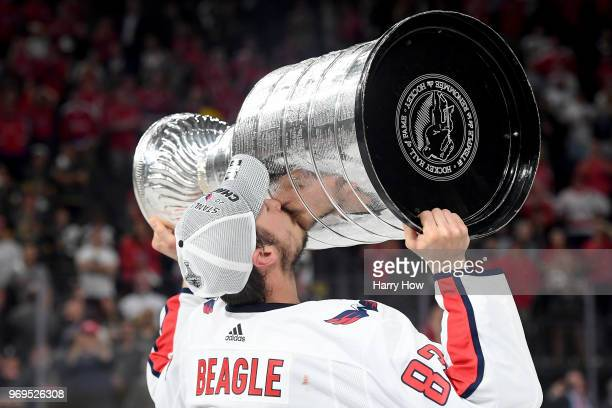Jay Beagle of the Washington Capitals hoists the Stanley Cup after his team defeated the Vegas Golden Knights 43 in Game Five of the 2018 NHL Stanley...