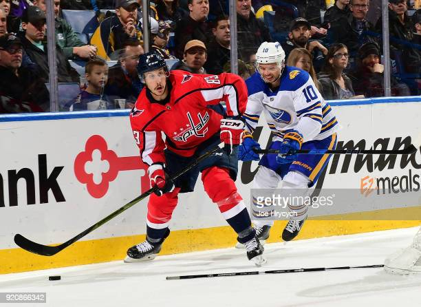 Jay Beagle of the Washington Capitals looks to pass while Jacob Josefson of the Buffalo Sabres defends during an NHL game on February 19 2018 at...