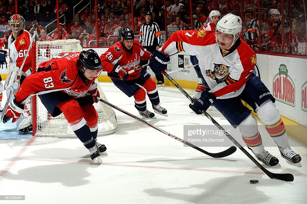 Jay Beagle #83 of the Washington Capitals pressures Dmitry Kulikov #7 of the Florida Panthers as he clears the puck during the first period of an NHL hockey game at Verizon Center on February 9, 2013 in Washington, DC.